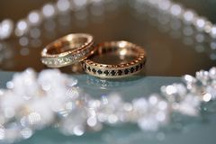 Gold wedding rings laying on the table Stock Image