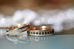 Gold wedding rings laying on the table Royalty Free Stock Photo
