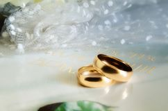 Gold wedding rings on a light surface. royalty free stock photo