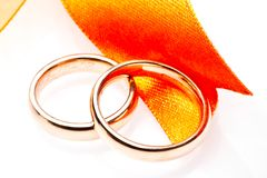 Gold wedding rings near ribbon Stock Photography