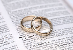 Gold wedding rings on a page showing love Royalty Free Stock Image