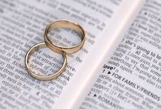 Gold wedding rings on a page showing love Stock Image