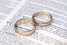 Gold wedding rings on a page showing love Stock Images