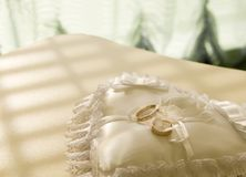 Gold wedding rings on a  pillow Stock Image