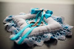 Gold wedding rings on the pillow with lace Royalty Free Stock Images