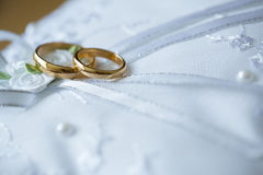 Gold wedding rings on a pillow. Stock Images