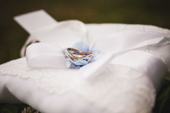 Gold wedding rings on a pillow Royalty Free Stock Photo