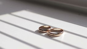 Gold wedding rings. On the pincushion stock video