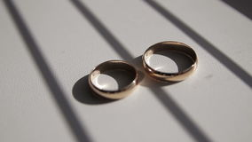 Gold wedding rings. On the pincushion stock footage