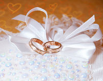 Gold wedding rings on the pincushion. Royalty Free Stock Images