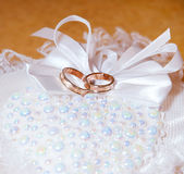 Gold wedding rings on the pincushion. Soft focus Royalty Free Stock Image