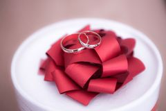 Gold wedding rings on red bow Stock Photo