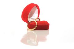 Gold wedding rings in red box. Isolated on white stock image