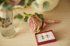 Gold wedding rings in red box. Gold wedding rings in a red box. Rose royalty free stock photos