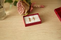 Gold wedding rings in red box. Gold wedding rings in a red box. Rose royalty free stock photography