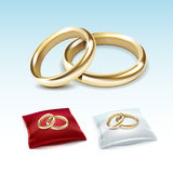 Gold Wedding Rings on Red White Satin Pillow  Stock Images