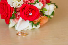 Gold wedding rings on satin pillow Stock Images