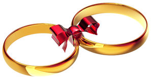 Gold wedding rings with the silk bow. As a symbol of the bond of marriage Royalty Free Stock Photo