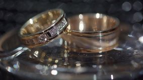 Gold wedding rings. Transfusion of light on rings. Gold wedding rings. Transfusion of light on rings. Gold wedding rings stock video