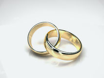 Gold wedding rings. Two gold wedding rings  on white background. yellow and white gold Royalty Free Stock Photos