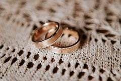 Gold wedding rings on vintage lace royalty free stock photo