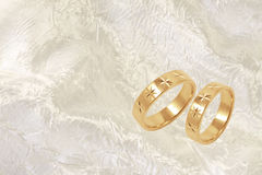 Gold wedding rings on white festive background Royalty Free Stock Image