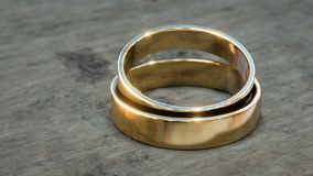 Gold wedding rings on wooden table 3d illustration. With copy space vector illustration