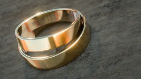 Gold wedding rings on wooden table 3d illustration. With copy space royalty free illustration