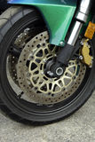 Gold Wheel. A gold colored wheel and brake system on a motorcycle stock image