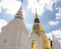 Gold and white asian pagoda. Gold and white old asian pagoda in Thailand Stock Photos