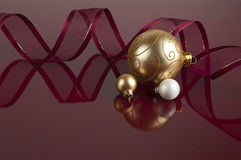 Gold and White Christmas balls on Maroon Royalty Free Stock Photography