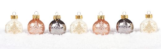 Gold and white Christmas bauble border in snow over white Stock Images