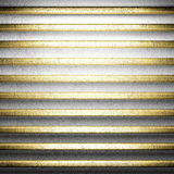 Gold on white concrete Stock Image