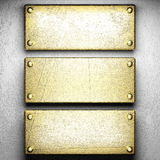 Gold on white concrete background Royalty Free Stock Photo