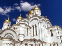 Gold and White Dome Building Under White Cumulus Clouds and Blue Sky Royalty Free Stock Photography