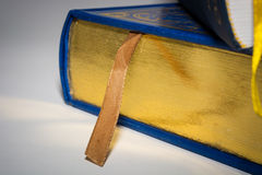 Gold and white edges of books with yellow and brown ribbons Stock Images