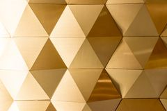 Gold - white geometric wall. Made from aluminum sheet. Gold White Polygonal  Background Royalty Free Stock Photo