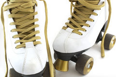 Gold and white rollerskates Stock Images