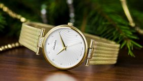 Gold and White Round Analog Watch at 10:15 Royalty Free Stock Image