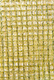 Gold wide ribbon braids on a white background. A gold wide ribbon braids on a white background Stock Image