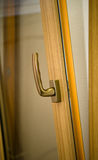 Gold window handle Royalty Free Stock Photography