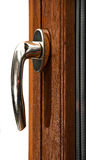 Gold window handle on oak  window Stock Photography