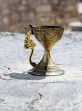 Gold wineglass with ornament (with path).  Stock Image