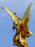 Gold wings. On a lady statue royalty free stock images