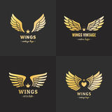 Gold wings logo vector set. Vintage hipster design. Part one. Royalty Free Stock Photo