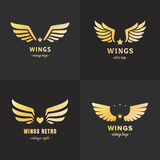Gold wings logo vector set. Vintage hipster design. Part two. Stock Images