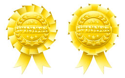 Gold winner rosettes. With the word winner in the centre and winners laurel wreath and stars Stock Images