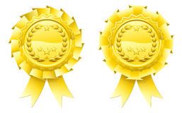 Gold winners laurel rosettes. Golden winners laurel rosettes with laurel wreath and stars in the centre and ribbon hanging down Royalty Free Stock Images