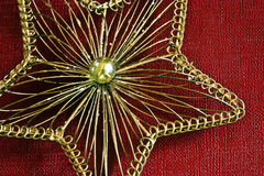 Gold wire star. A close-up of a gold wire christmas star Royalty Free Stock Photo