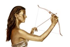 Gold woman with a bow and arrow Stock Photography